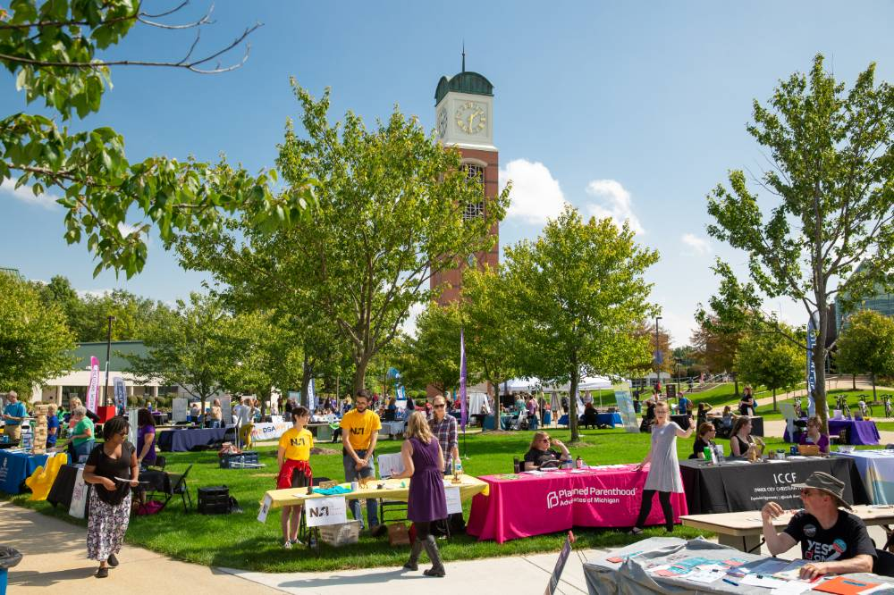 General shot of event containing employer booths and gvsu clock tower